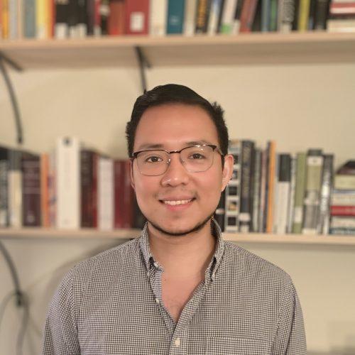 Daniel Dominguez headshot with bookshelves