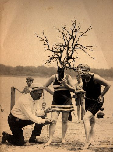 Image of woman with branch as face, whose bathing suit is being measured
