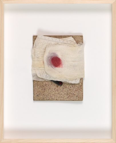 Mixed media artwork showing a spot of blood on gauze