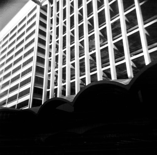 A side angle shot of a building in black and white.