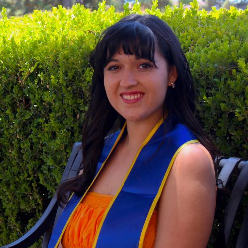Color photograph of the author Isabelle Rubio in graduation stole