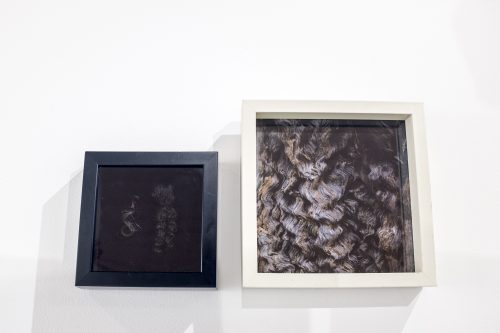 color photograph of two different picture frames each with images
