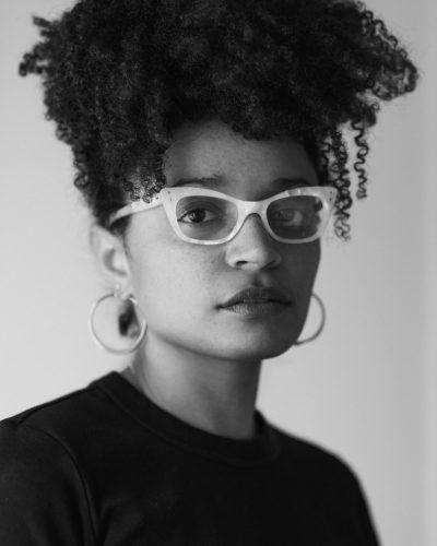black and white photographic headshot of the artist Savannah Wood